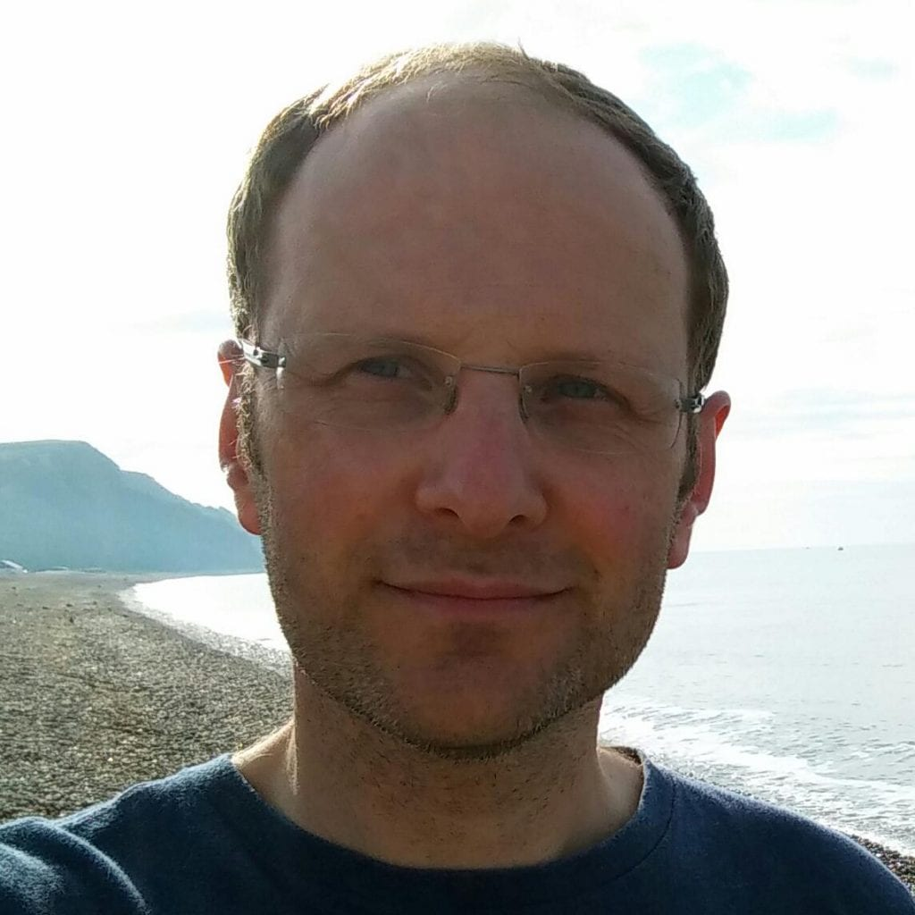 Andy Wood on beach.