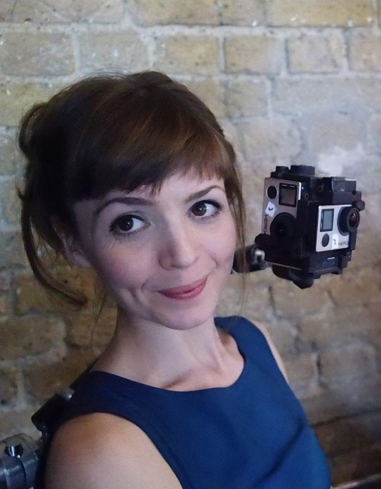 Jane Gauntlett smiles with camera next to her head.