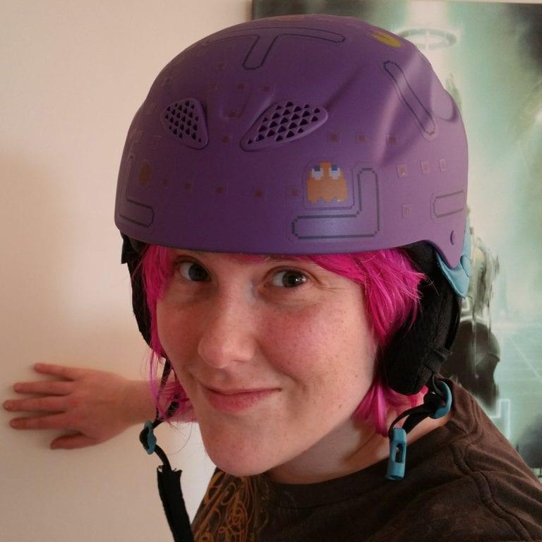 Katie Goode wearing helmet and smiling at camera.