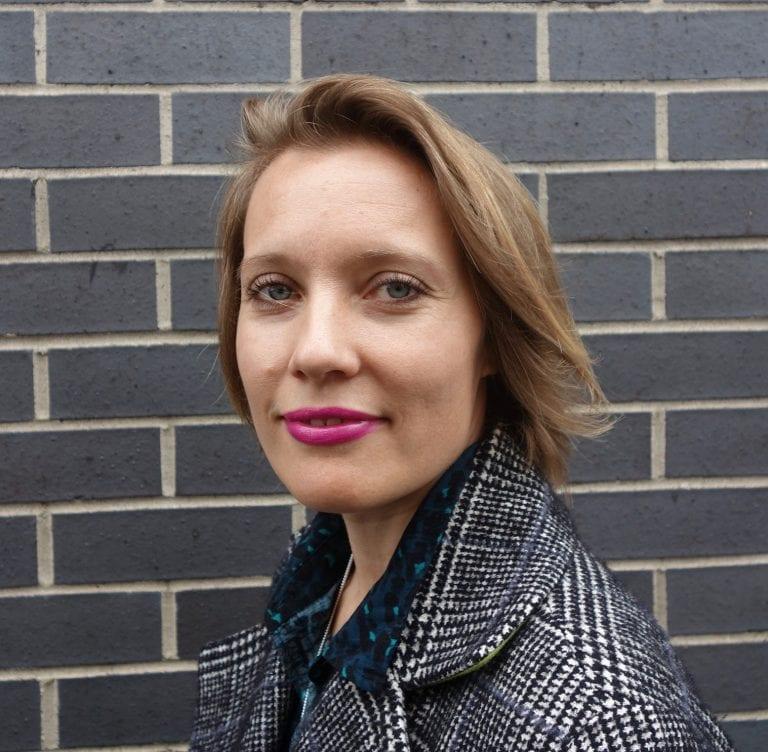 Dr Hannah Wood smiles at camera.