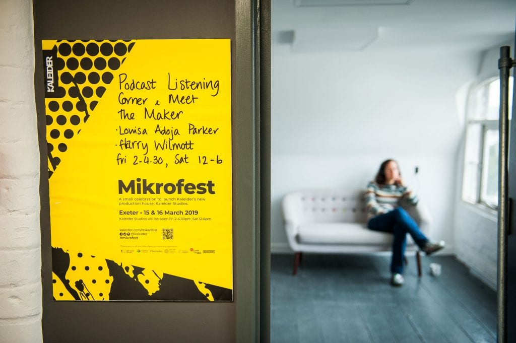 Picture of poster attached to wall for Mikrofest.