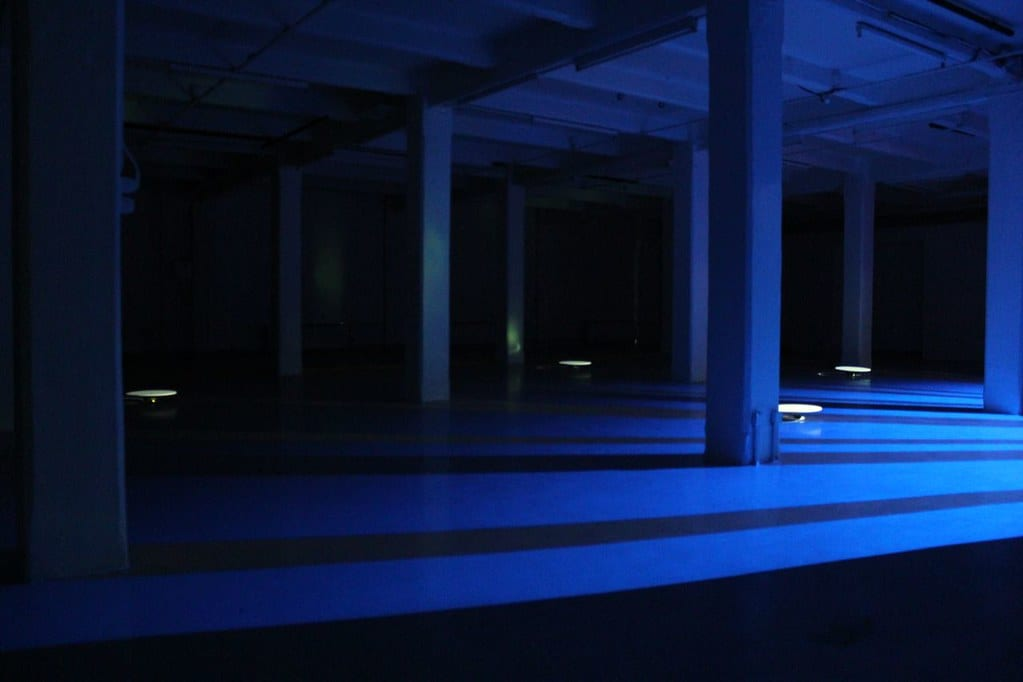 Dark room with pillars lit up in blue.