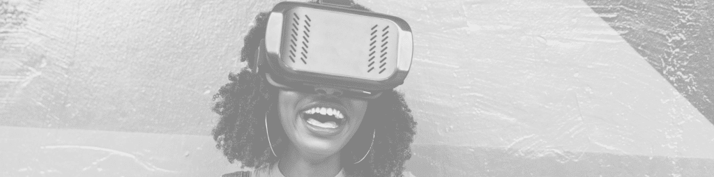 Woman wears VR headset smiling.