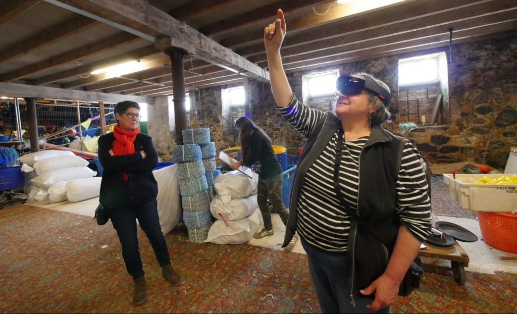 Woman wearing VR headset at The Fish Cellar at Porthmeor, St Ives.