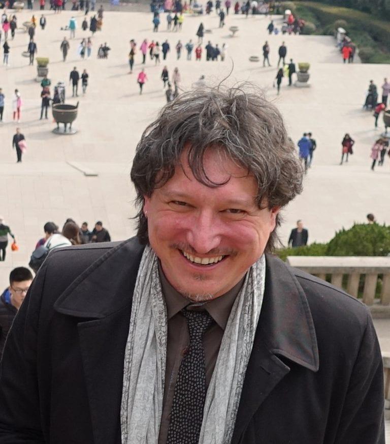 Gianni Corino smiling at camera.