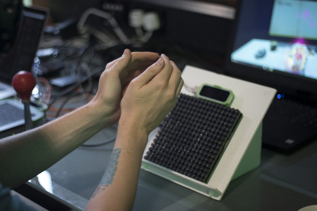 A person using a Leap Motion to detect the movement of the hands
