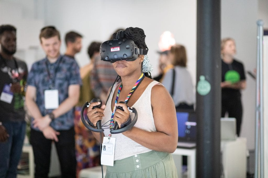 Woman using VR headset at an event at SWCTN Showcase