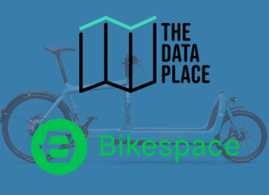image of a bike on a blue background. the text in front reads The Data Place and Bikespace