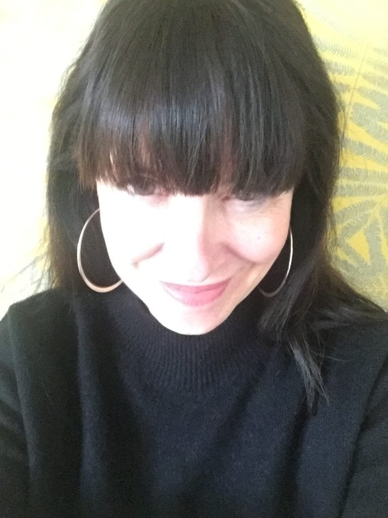 image of Melissa Blackburn, she is female with dark hair and a fringe, wearing a black jumper